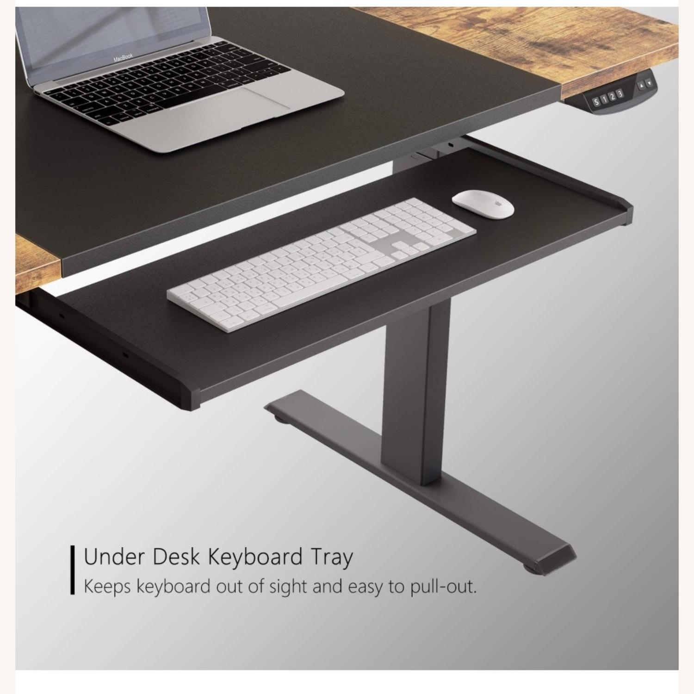 FEZIBO Height Adjustable Electric Standing Desk - image-4