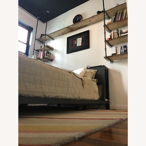 Used Custom Iron Pipe and Reclaimed Wood Shelves for sale on AptDeco
