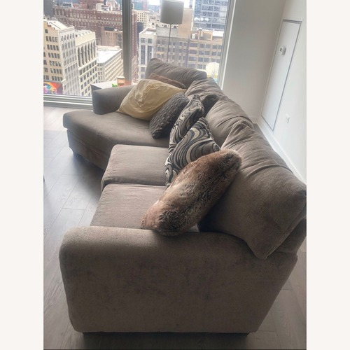 Used Microfiber 2 piece Sectional includes the Cuddler for sale on AptDeco