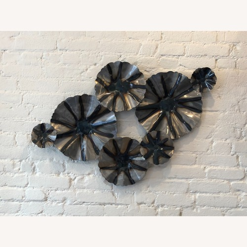 Used Industrial Metal Wall Art with a Floral Motif for sale on AptDeco