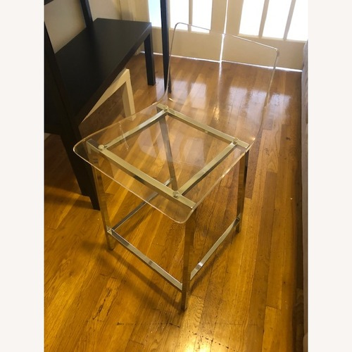 Used Clear Modern Bar Stool with Back and Chrome Legs for sale on AptDeco