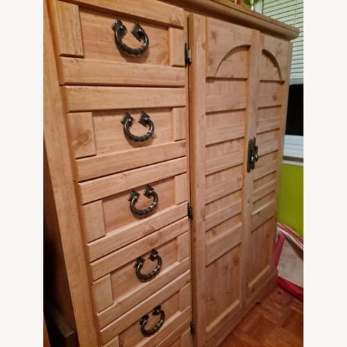 Used Roma Furniture Armoire for sale on AptDeco