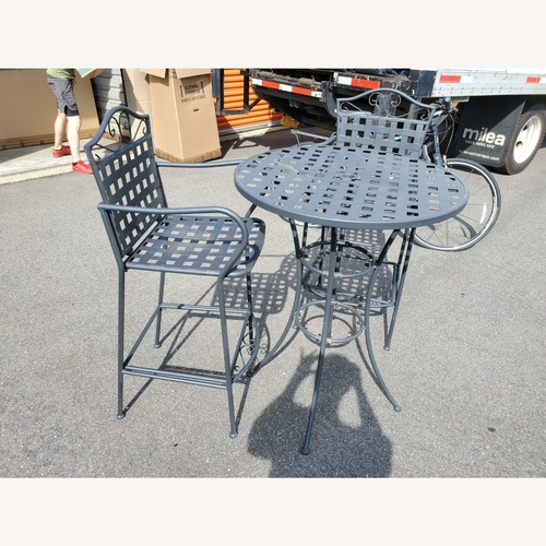 Used Hayneedle Outdoor Hightop Bar Table and 2 Seats for sale on AptDeco