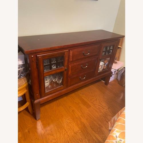 Used Raymour & Flannigan Dark Brown Cabinet for sale on AptDeco