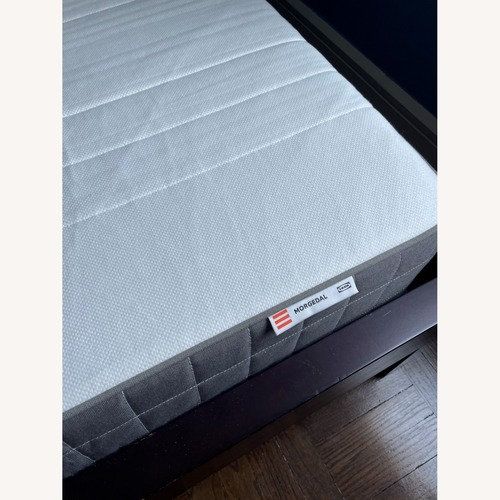 Used Full Size Bed with Modern Headboard for sale on AptDeco
