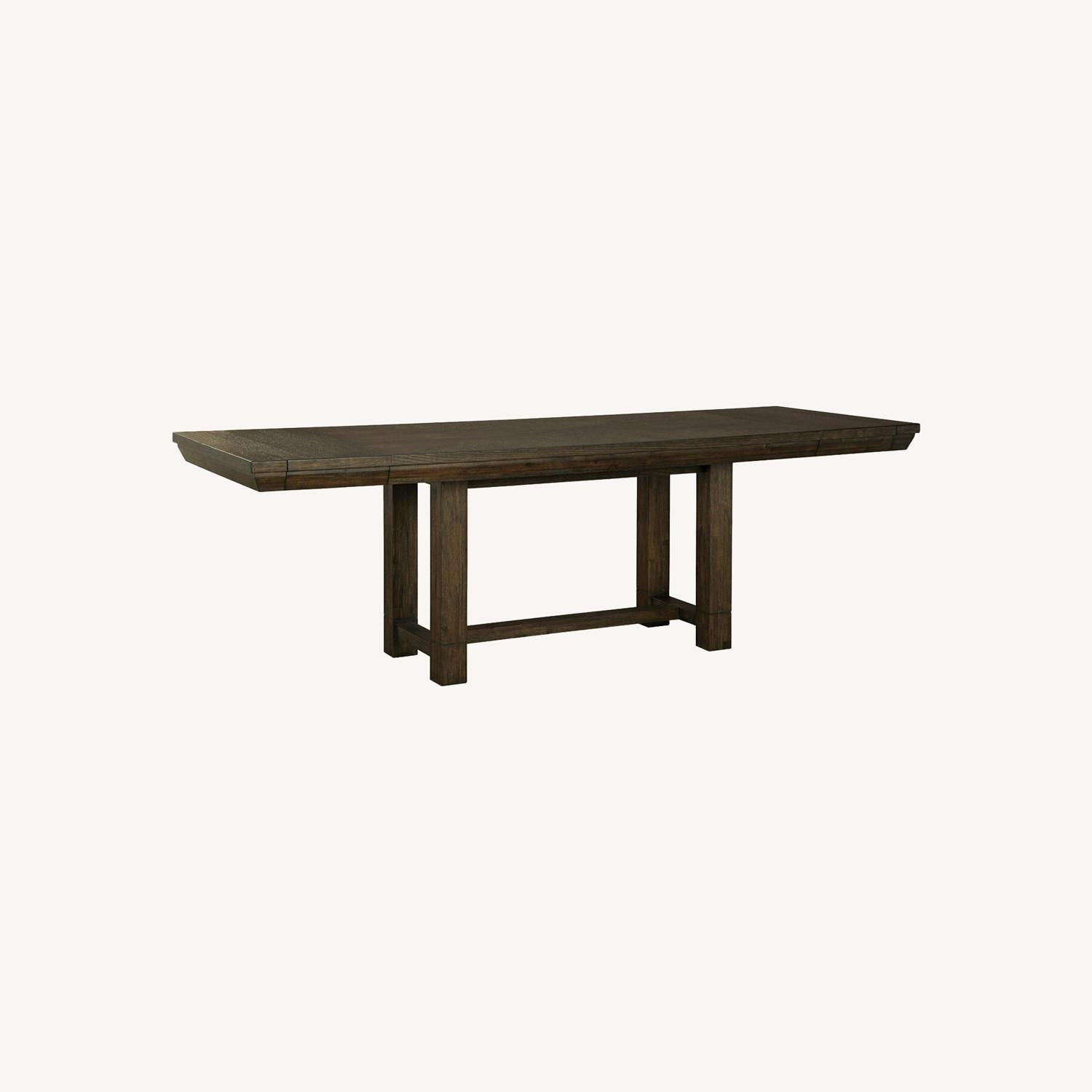 Ashley Furniture Dellbeck Extendable Dining Table - image-0