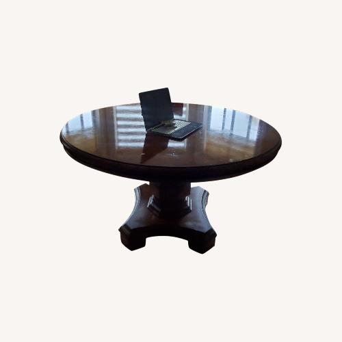Used Solid Wood Round Dining Table 52W52D31L for sale on AptDeco