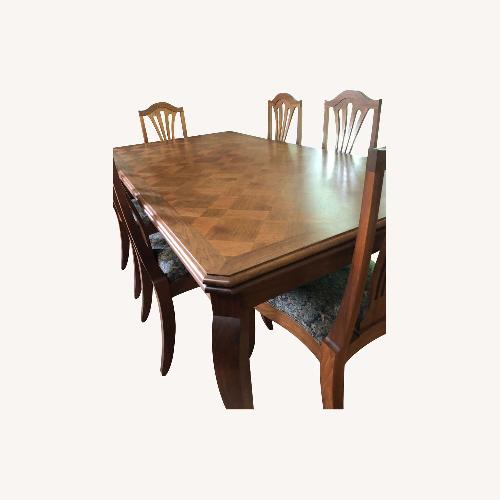 Used Custom Made Dining Table and 8 Chairs for sale on AptDeco