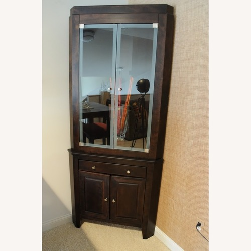 Used Canadel Corner Curio Cabinet with Light for sale on AptDeco