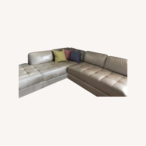 Used Platinum Leather Sectional for sale on AptDeco