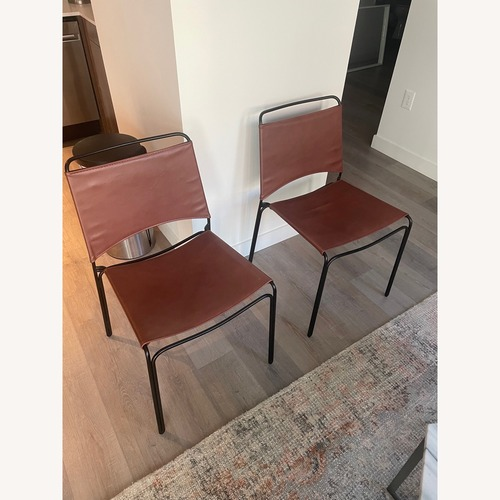 Used France & Son 2 Trace Leather Dining Chairs for sale on AptDeco