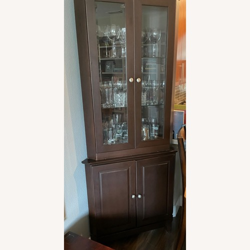 Used Corner Curio Cabinet for sale on AptDeco