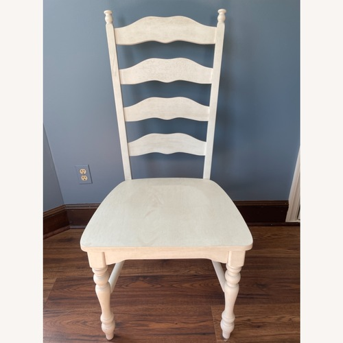 Used Whitewashed Ladderback Solid Wood Dining Chair for sale on AptDeco
