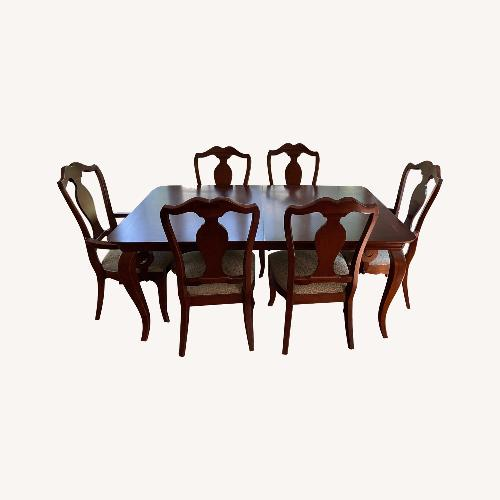 Used Thomasville Dining Table Set, 6 Chairs + extenders for sale on AptDeco