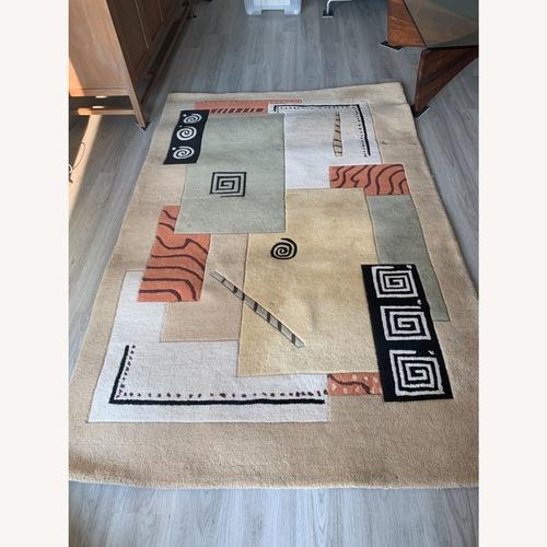 Used Momeni Area Rug Hand Woven for sale on AptDeco