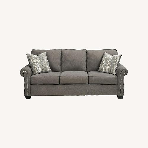 Used Raymour & Flanigan Grey Chenille Sofa for sale on AptDeco