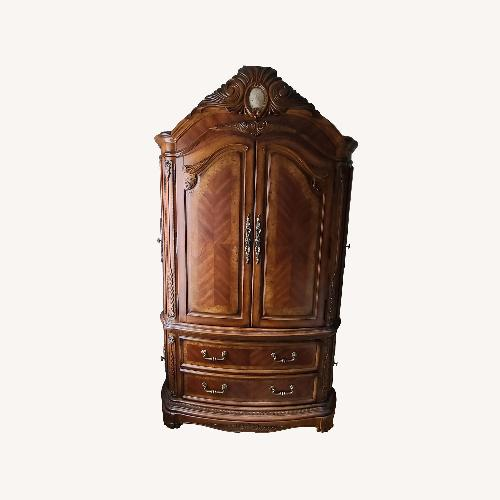 Used Michael Amini Solid Birchwood Armoire with Marble Cameo for sale on AptDeco