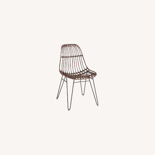 Used World Market Rattan Hairpin Dining Chairs with Rustic Legs for sale on AptDeco