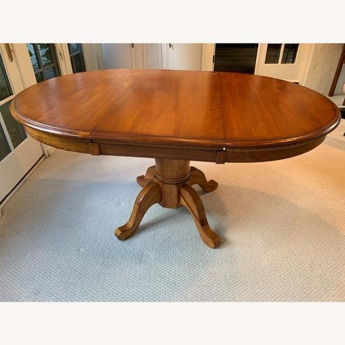 Used Kincaid Furniture Medium Extendable Solid Wood Dining Table for sale on AptDeco