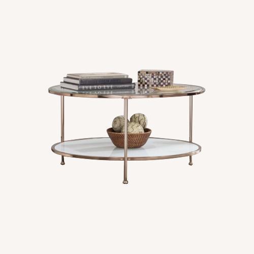 Used Walmart Round Glass & Metal Coffee Table for sale on AptDeco