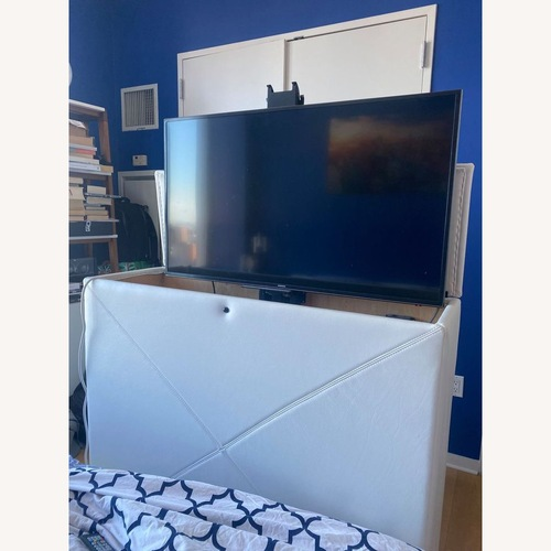 Used Custom leather automatic TV storage, up to 45 TV for sale on AptDeco