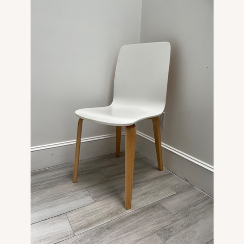 Used Anthropologie White Tamsin Dining Chairs (4) for sale on AptDeco