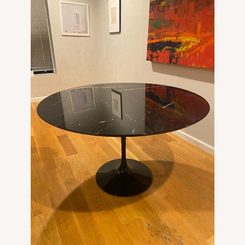 Used Eero Saarinen 47r Dining Table in Black Marble for sale on AptDeco