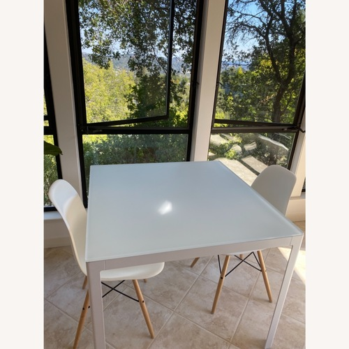 Used Design Within Reach White Table with 2 Eames Chairs for sale on AptDeco