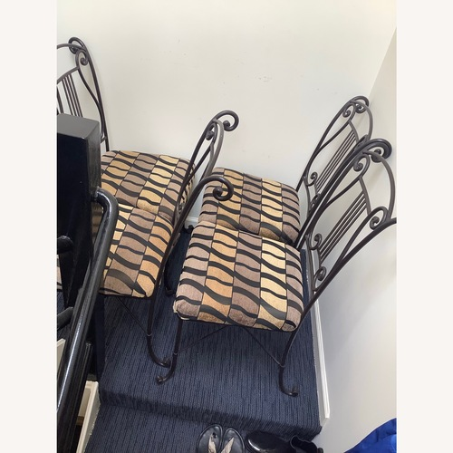 Used Black Wrought Iron Dining Chairs Set of 4 for sale on AptDeco