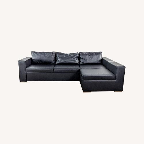 Used Modani Black Sectional Sofa for sale on AptDeco