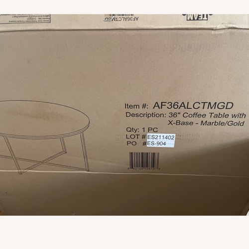 Used Walker Edison Faux Marble & Gold 36 Coffee Table for sale on AptDeco