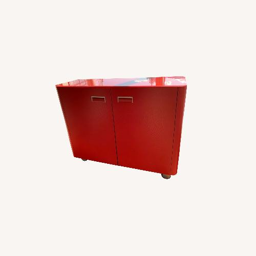 Used Ligne Roset Glossy Glass Red cabinet for sale on AptDeco