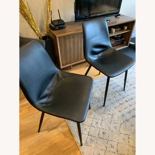 Used Black Leather Dining Chairs (Set of 2) for sale on AptDeco