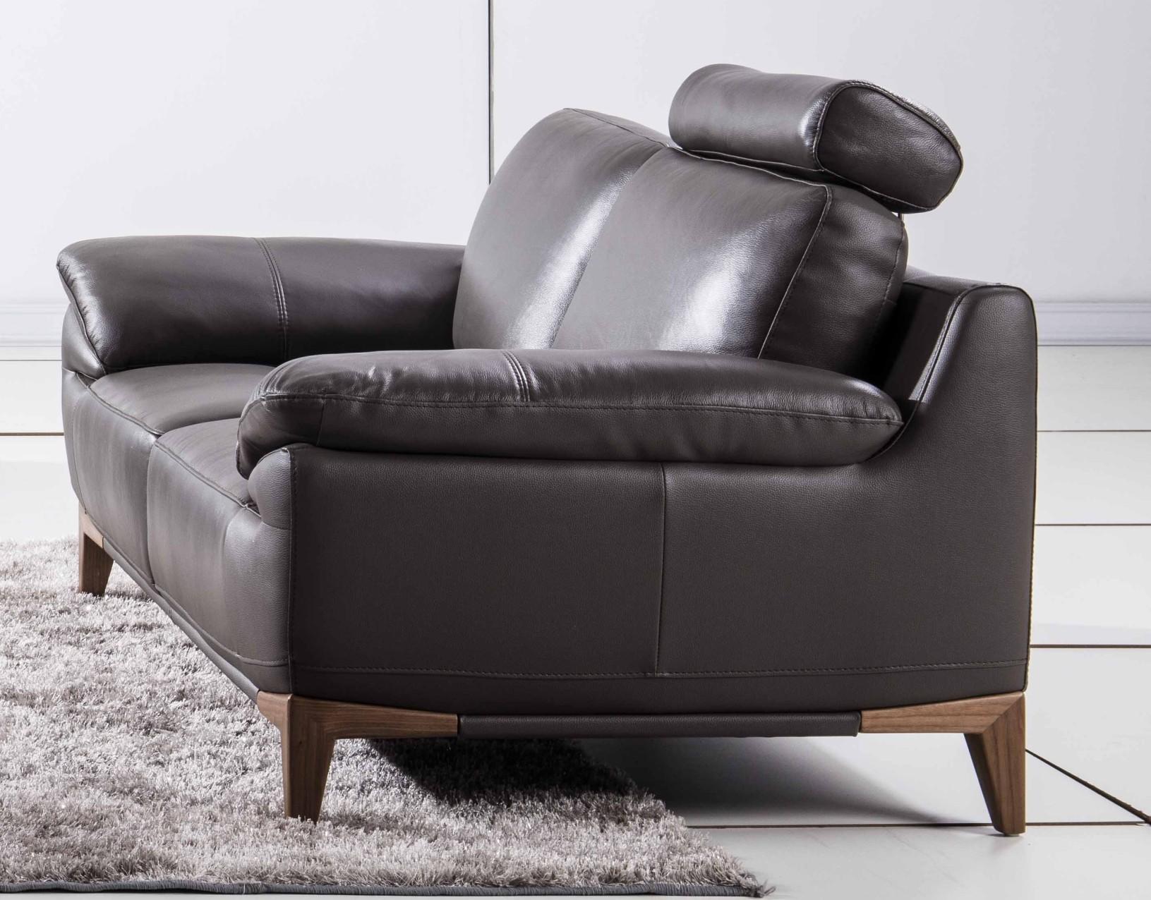 Mid Century Style Sofa With An Adjustable Headrest In Dark