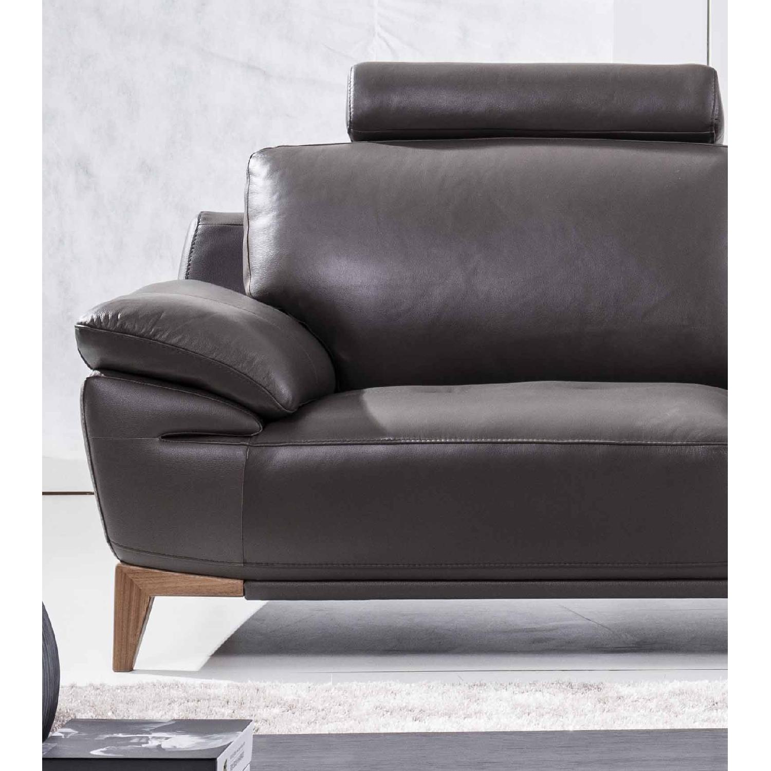 Mid Century Style Sofa With An Adjustable Headrest In Dark Grey Genuine Leather