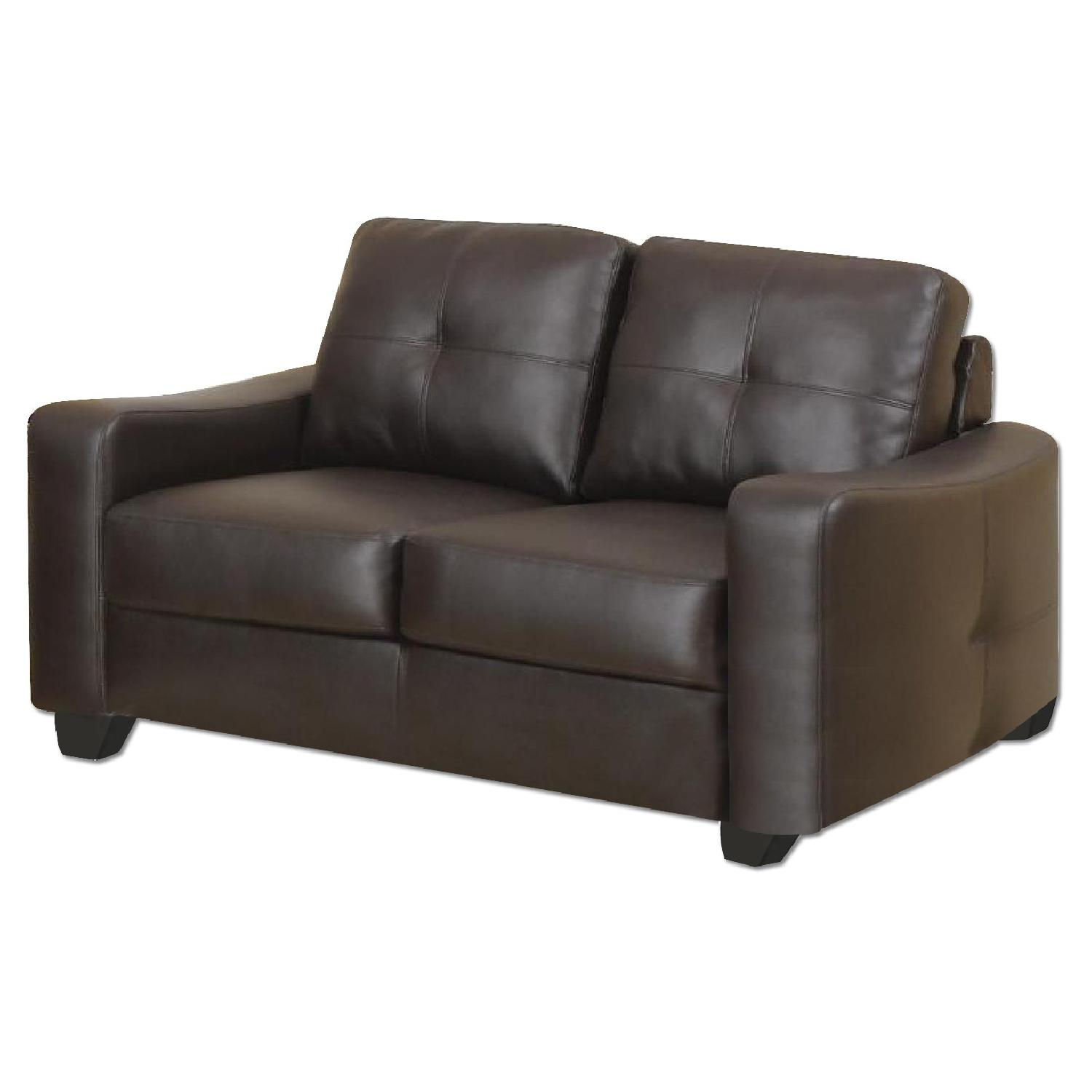 Brown Bonded Leather Loveseat w/ Curved Arms & Tufted Back &