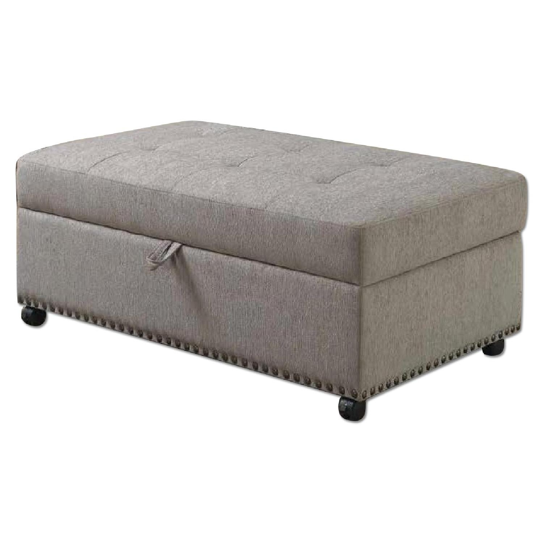 Convertible Sleeper Ottoman in Grey Fabric w/ Lockable Wheels & Nailhead Trim