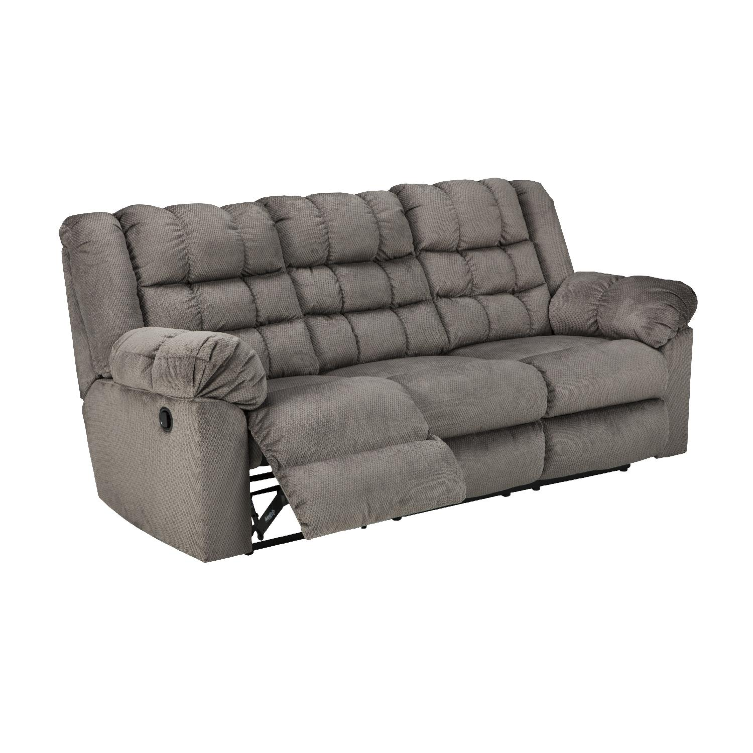 Ashley S Contemporary Reclining Sofa In Charcoal Color