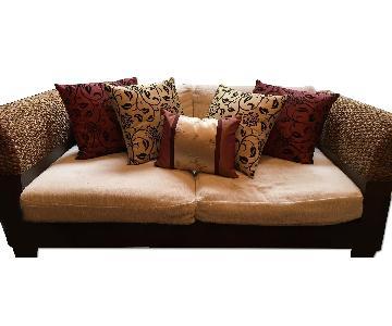 Dark Wood & Rattan Loveseat w/ Cream Color Cushions